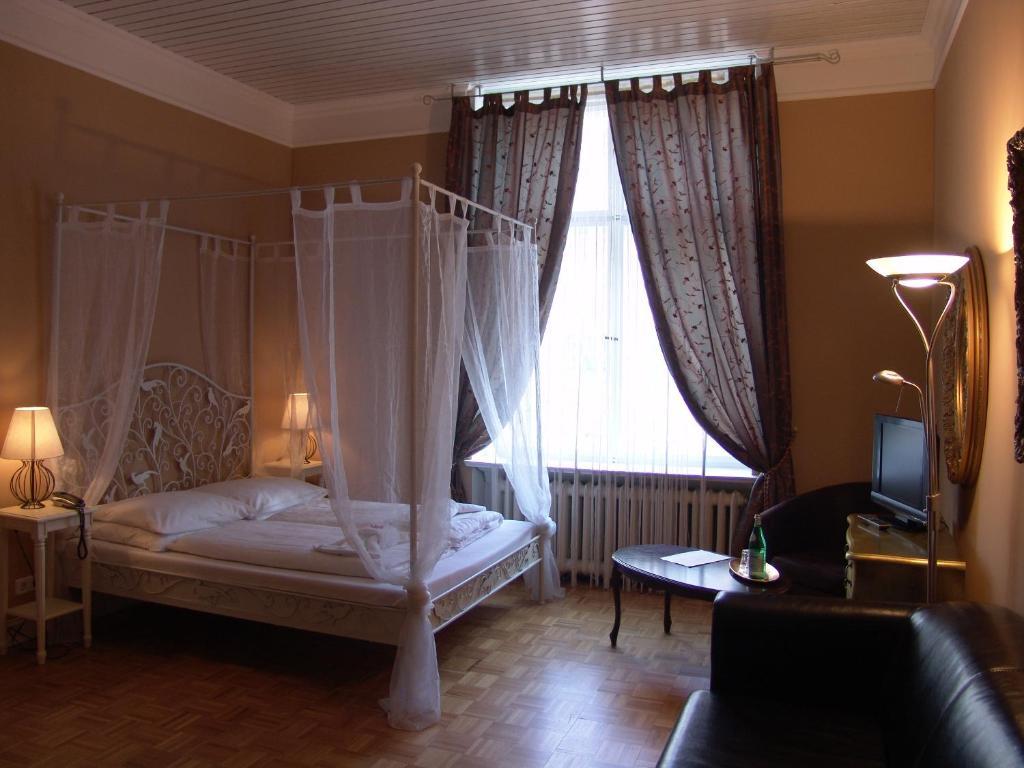 Кровать или кровати в номере Hotel-Maison Am Olivaer Platz