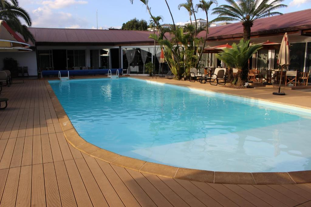 The swimming pool at or close to Relais des Plateaux & Spa– Ivato International Airport