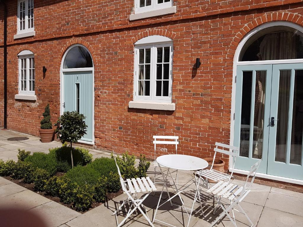 A porch or other outdoor area at Meynell Mews
