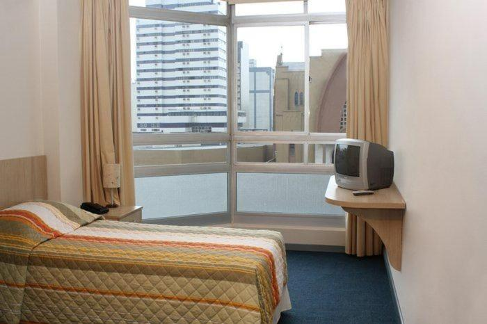 A bed or beds in a room at Euro Hotel