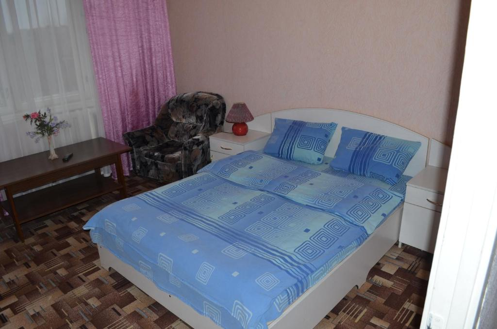 A bed or beds in a room at Hostel Vizit