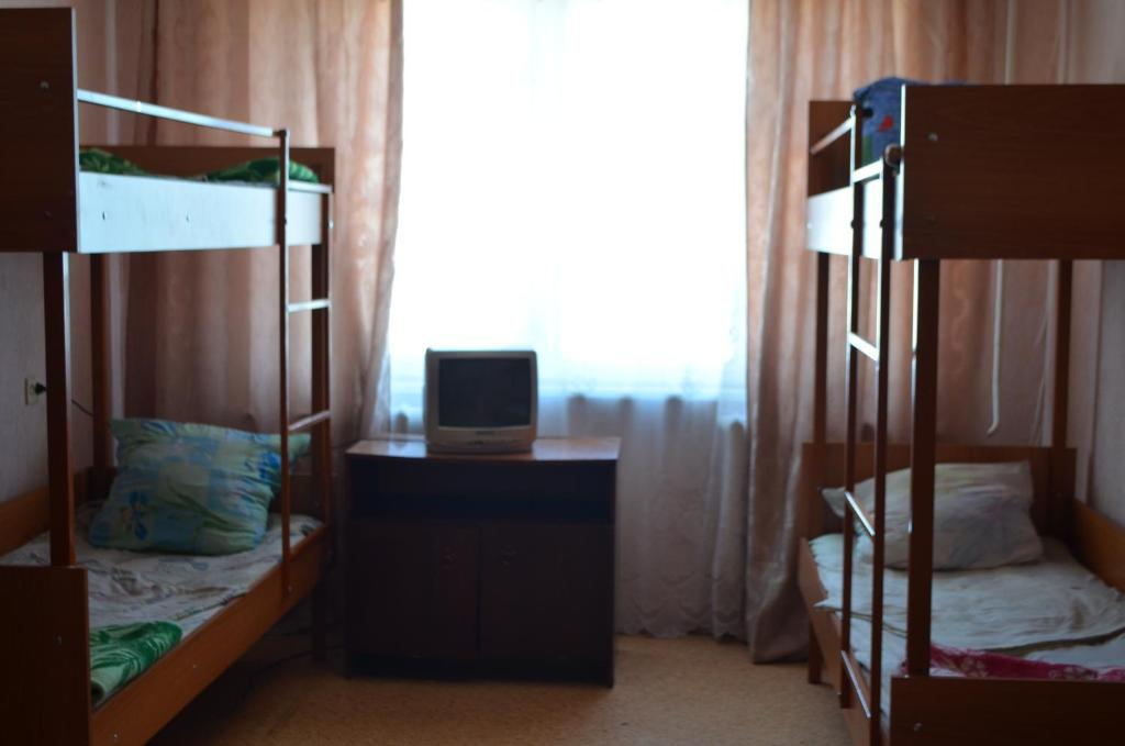A bunk bed or bunk beds in a room at Hostel Vizit