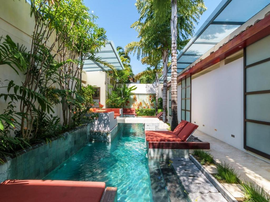 The swimming pool at or near Bali Ginger Suites & Villa