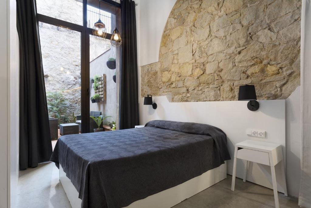 Ein Bett oder Betten in einem Zimmer der Unterkunft ApartEasy - Eixample LOFT - 3 Open Bedrooms