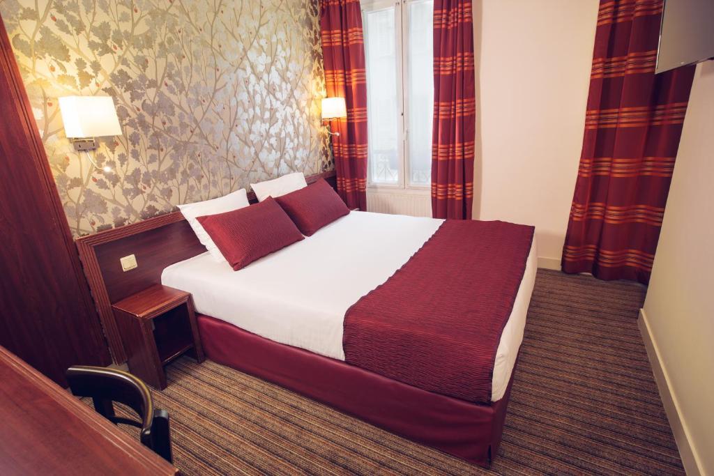 Ein Bett oder Betten in einem Zimmer der Unterkunft Timhotel Paris Gare de Lyon