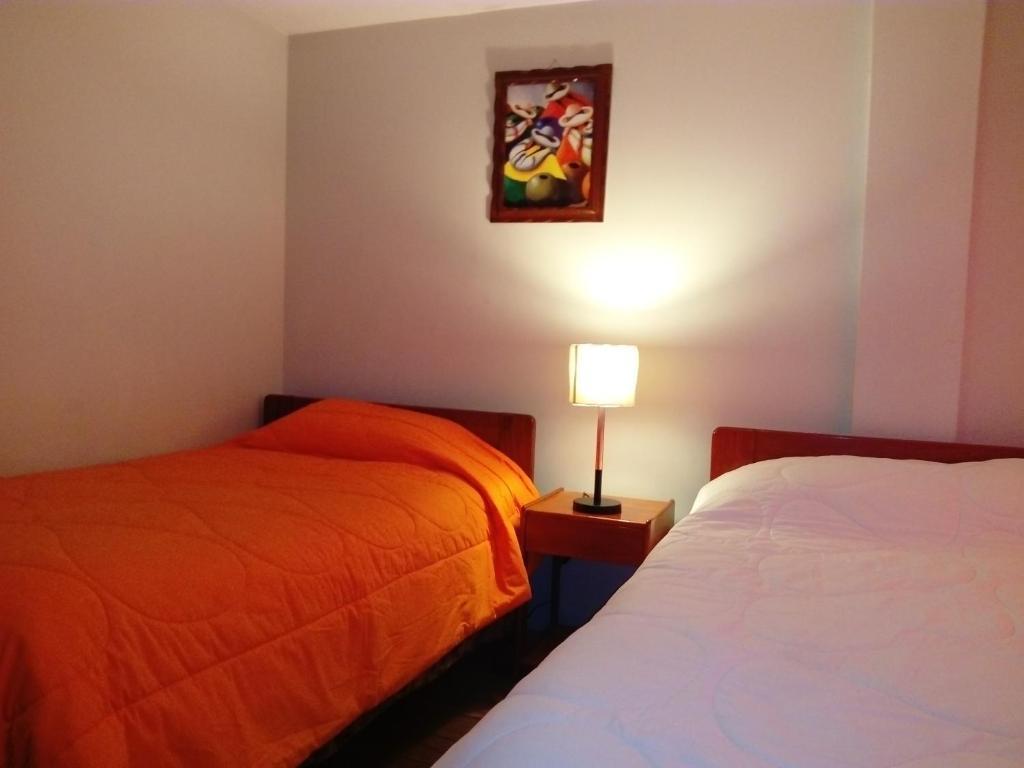 Cama o camas de una habitación en Hospedaje Keros B&B