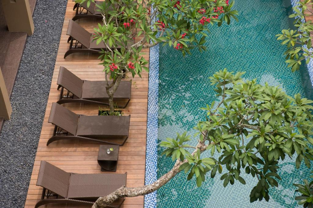 A view of the pool at Hotel Santika Kuta or nearby