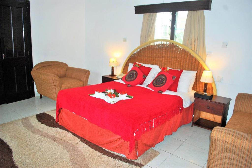 A bed or beds in a room at Nyali Sun Africa Beach Hotel & Spa