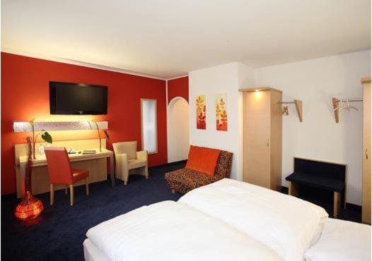 Postel nebo postele na pokoji v ubytování Hotel Silberhorn