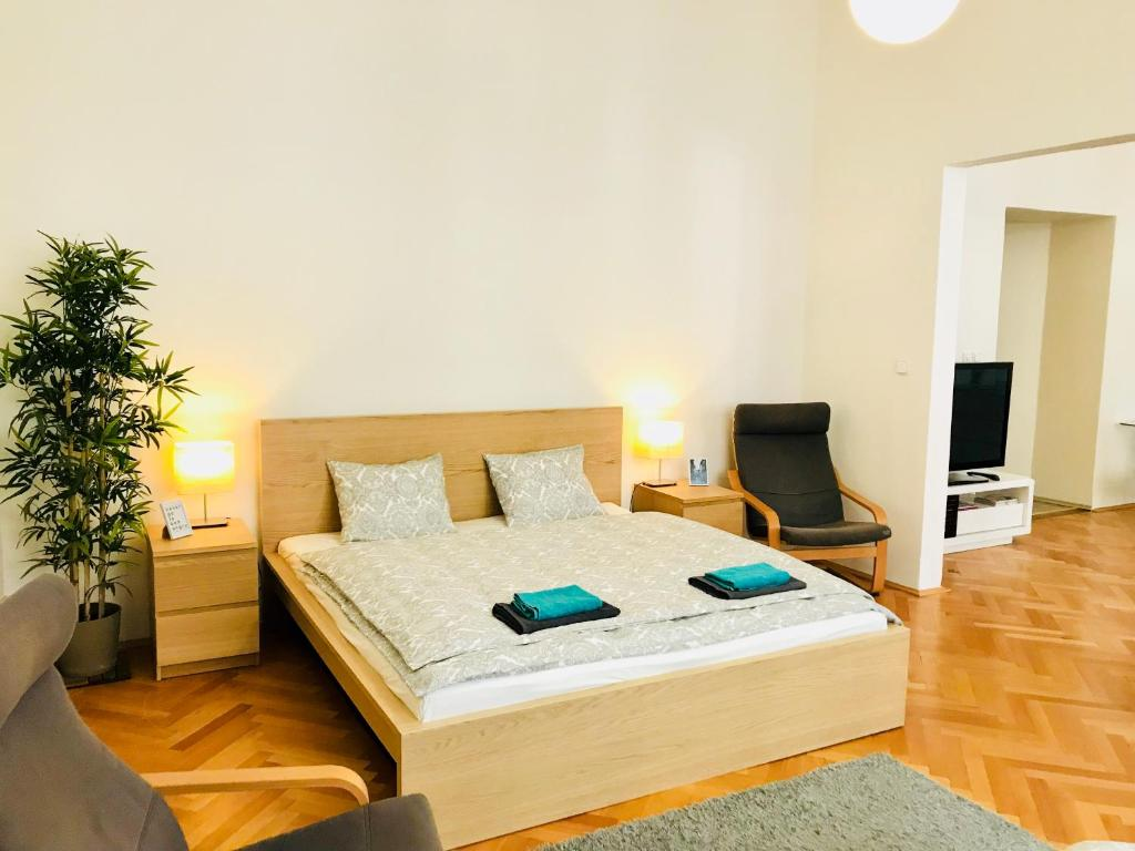 A bed or beds in a room at Jindrisska Central Stay