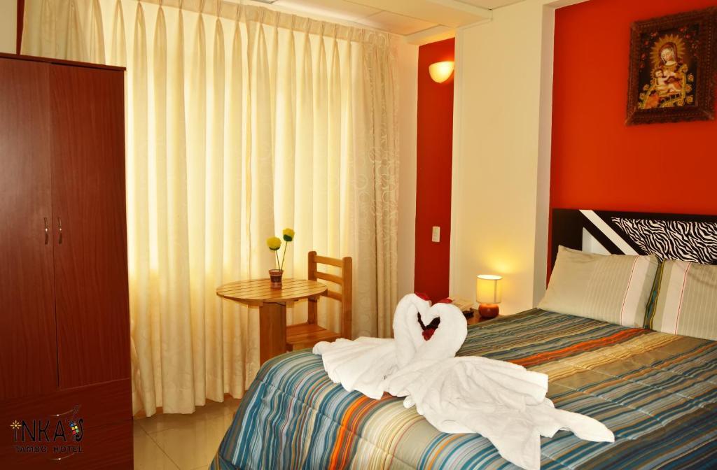 Cama o camas de una habitación en Inkas Tambo
