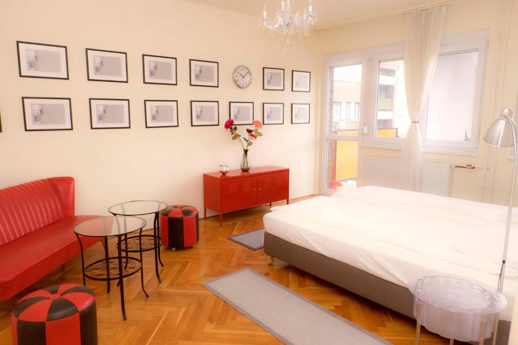 Postel nebo postele na pokoji v ubytování Budapest Expo Apartment