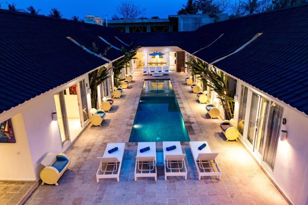 Pemandangan kolam renang di Tamoa Boutique Hotel atau di dekatnya