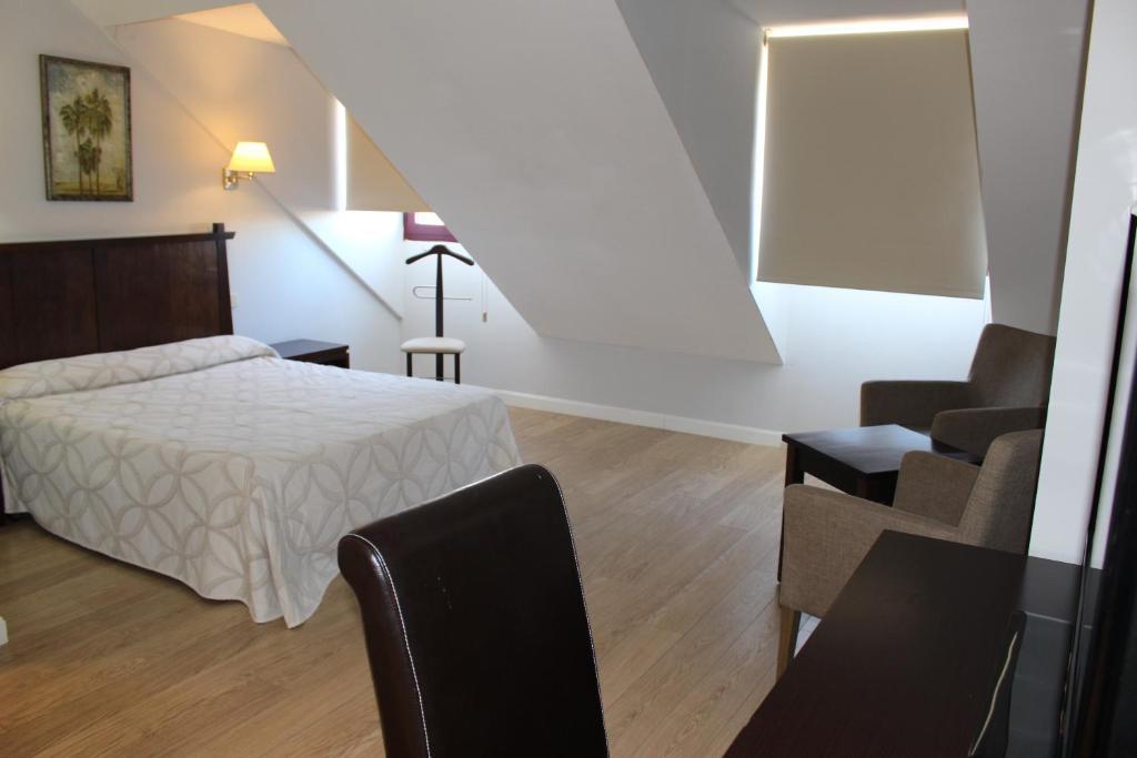Ein Bett oder Betten in einem Zimmer der Unterkunft Apartahotel Villa de Parla