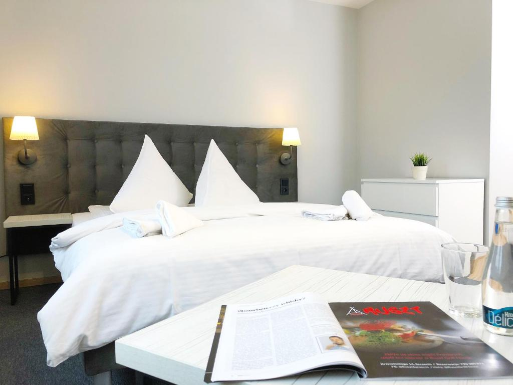 A bed or beds in a room at Residence Aparthotel
