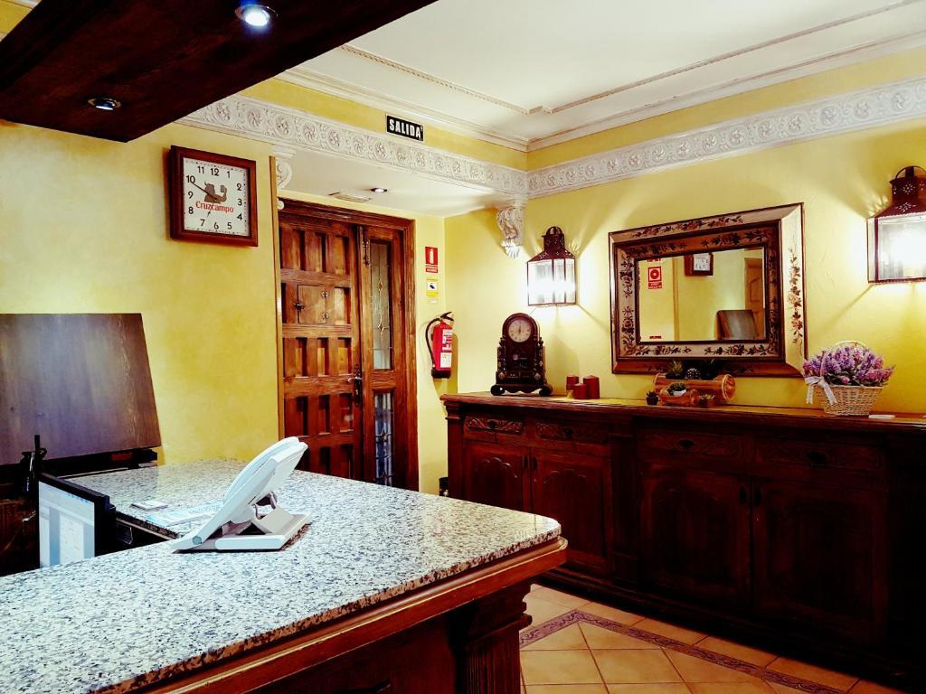 The lobby or reception area at Hostal Maria Ronda