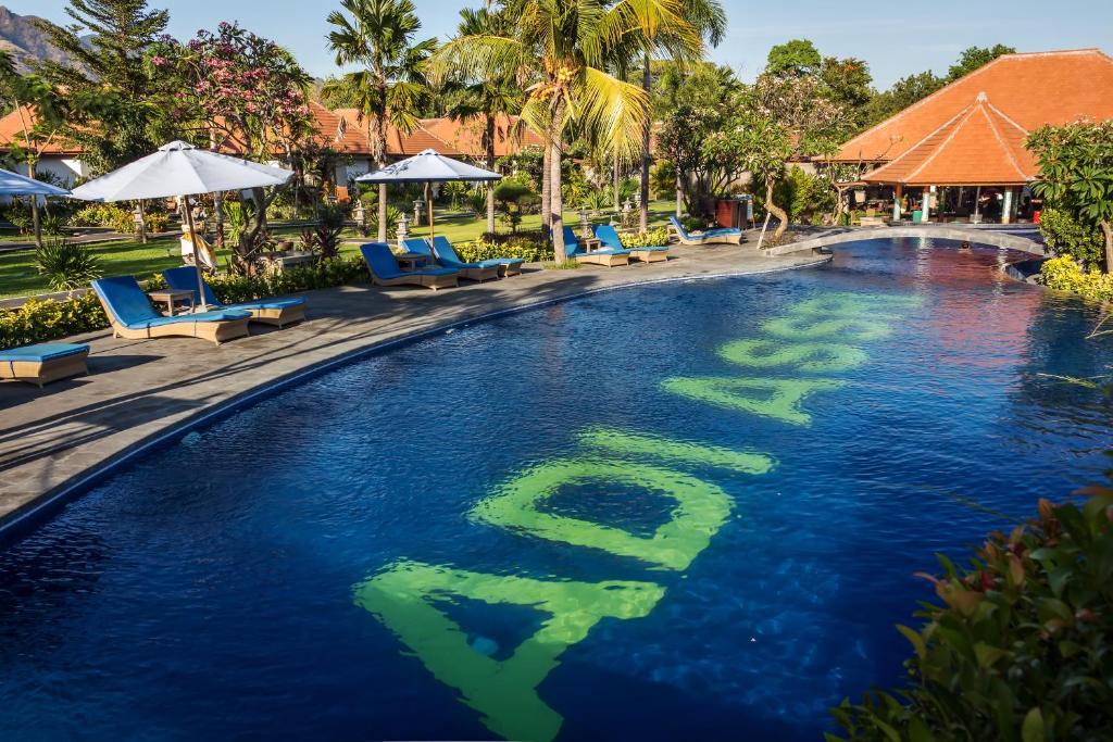 The swimming pool at or near Adi Assri Beach Resorts And Spa Pemuteran