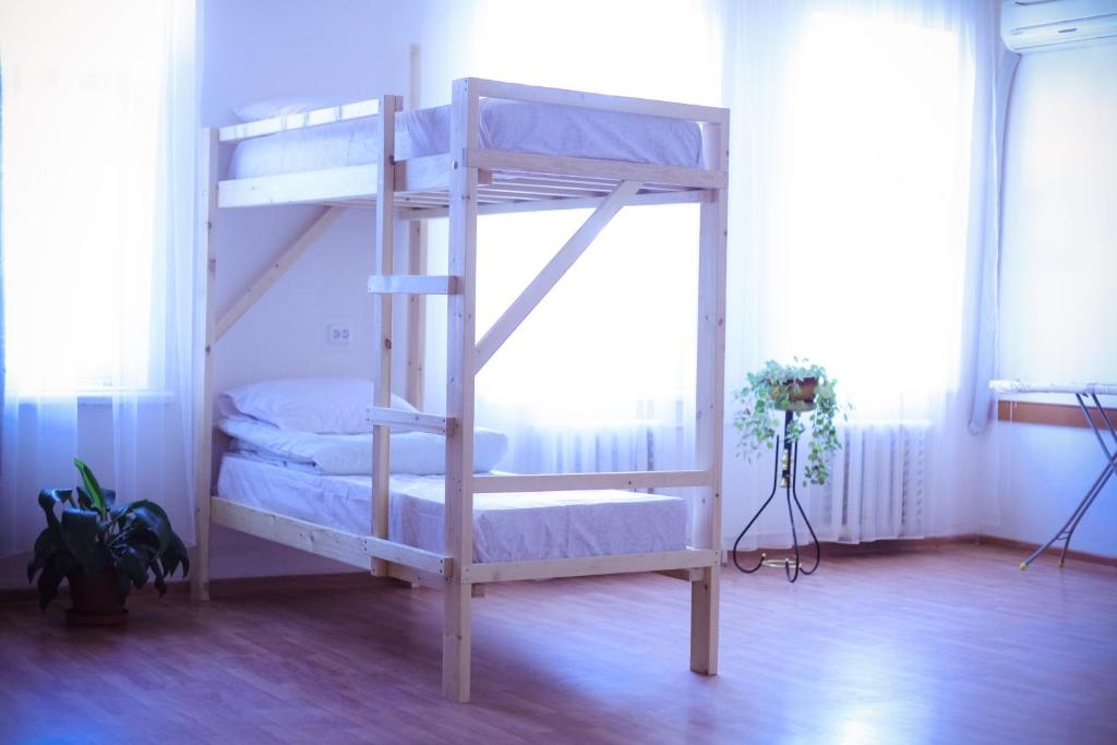 A bunk bed or bunk beds in a room at Hostel Tsentral