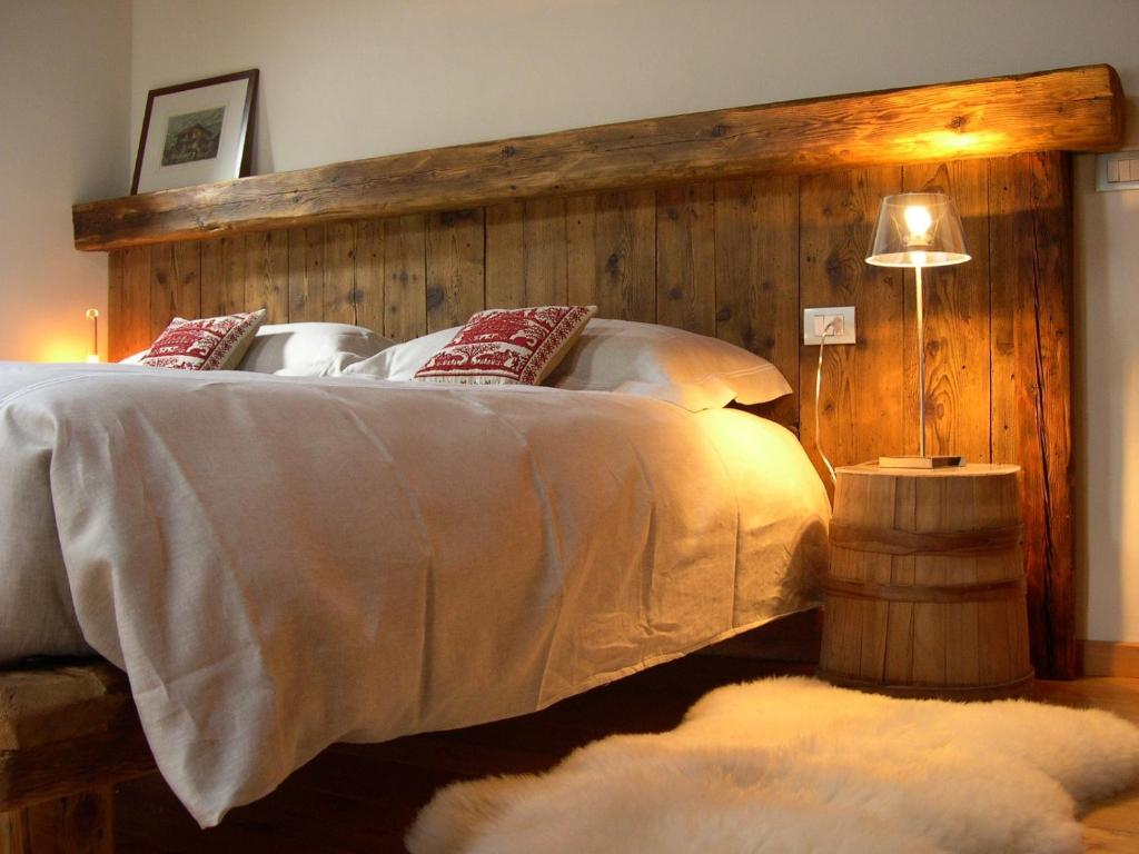 A bed or beds in a room at Tre Alberi Liberi