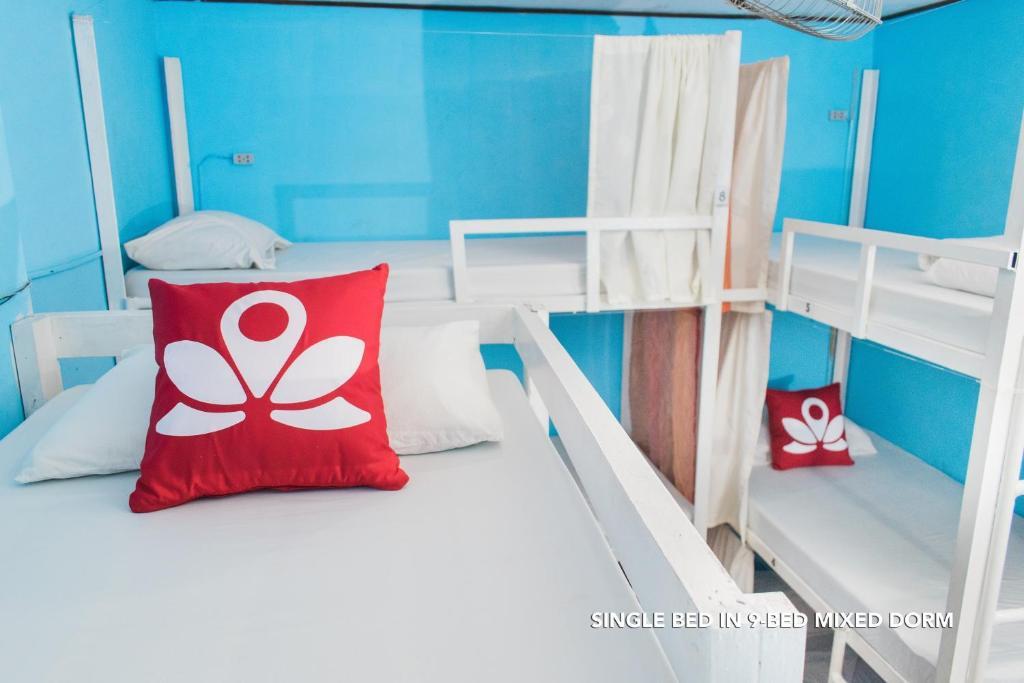 A bunk bed or bunk beds in a room at ZEN Hostel OMP El Nido