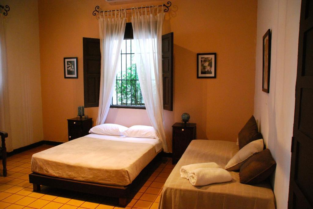 Ein Bett oder Betten in einem Zimmer der Unterkunft Hotel del Parque