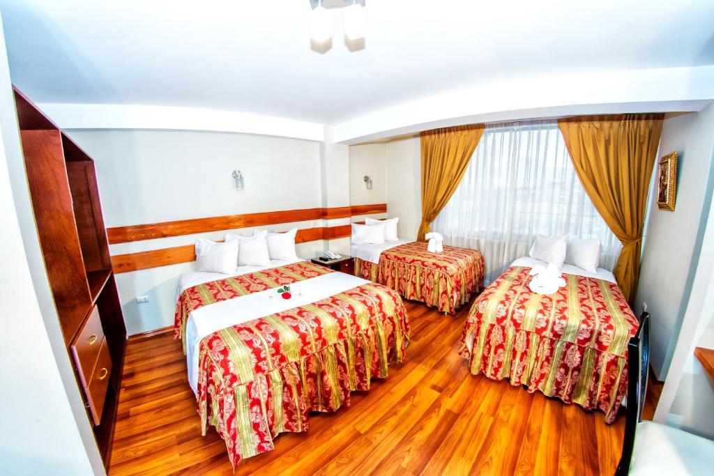 Cama o camas de una habitación en Hostal Los Andes