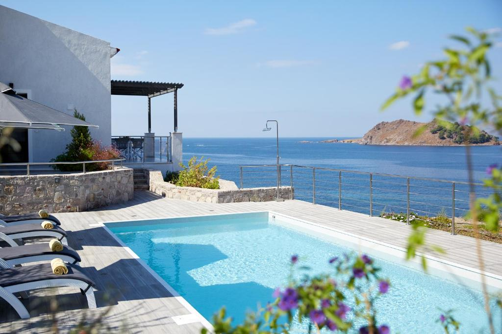 The swimming pool at or near Eleia Seafront Villas