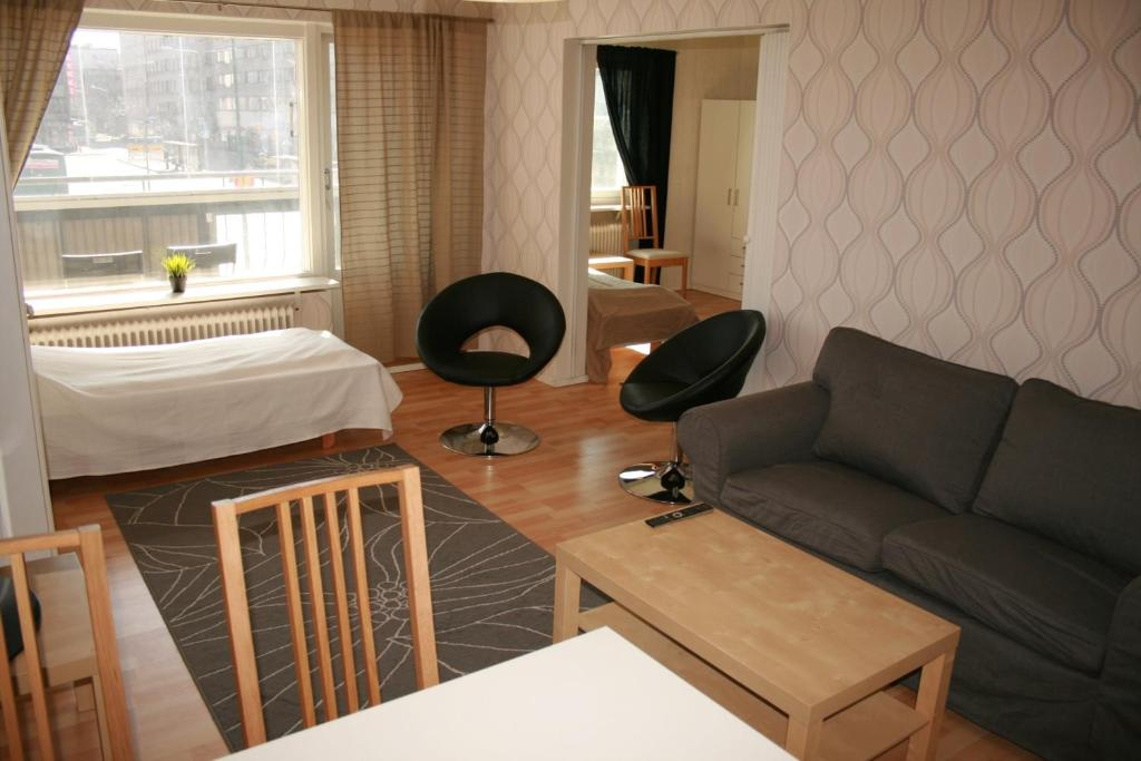A seating area at Twin bedroom apartment at the heart of Pori! (ID 2981)