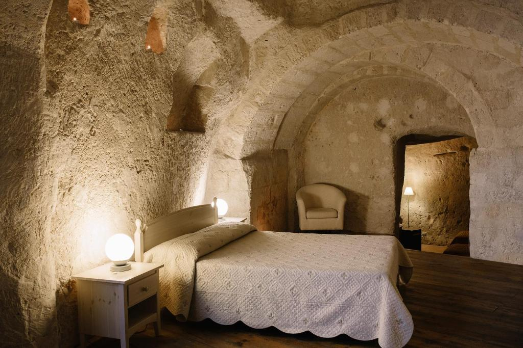 Posteľ alebo postele v izbe v ubytovaní Residence Sassi San Gennaro