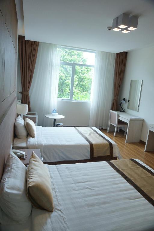 Giường trong phòng chung tại Hung Vuong Hotel