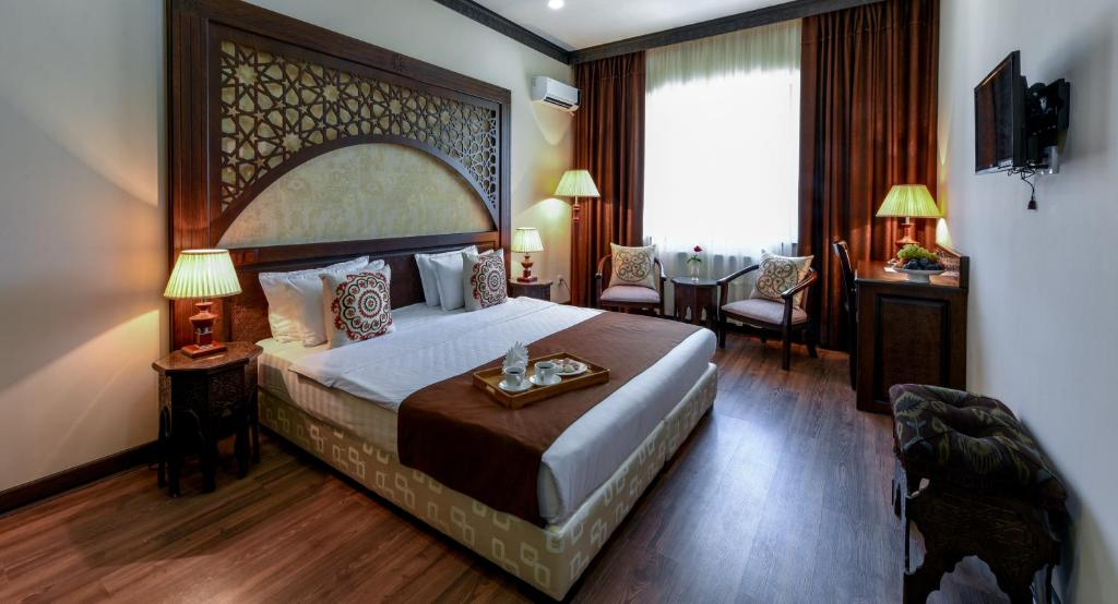 Ein Bett oder Betten in einem Zimmer der Unterkunft Orient Star Hotel