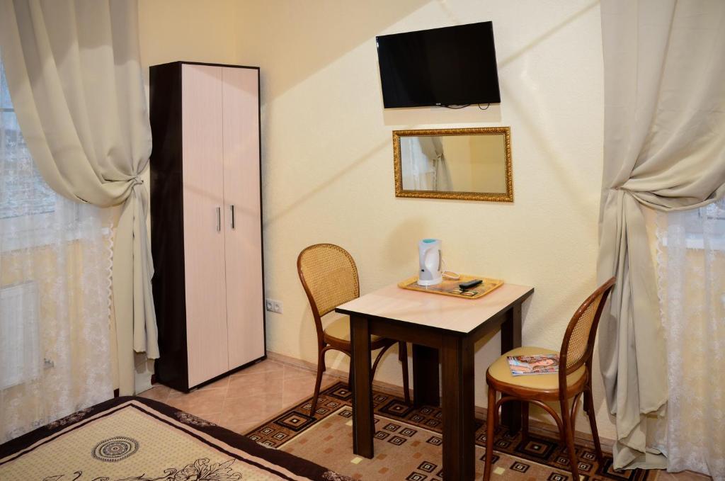 Телевизор и/или развлекательный центр в Отель Александрия-Домодедово