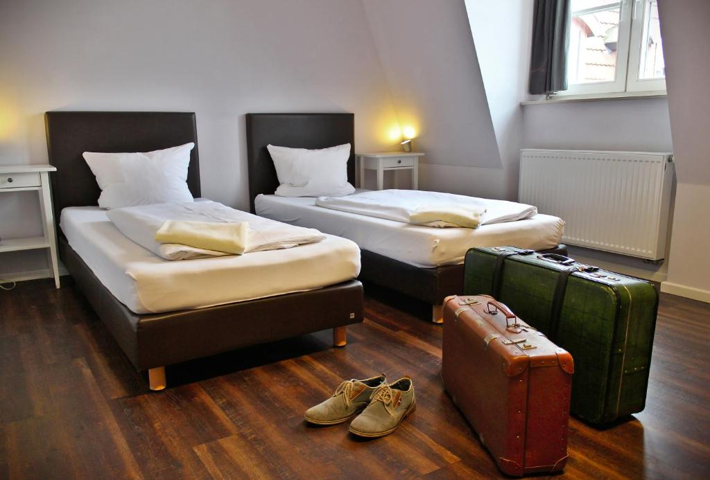 A bed or beds in a room at Industriepalast Hostel & Hotel Berlin