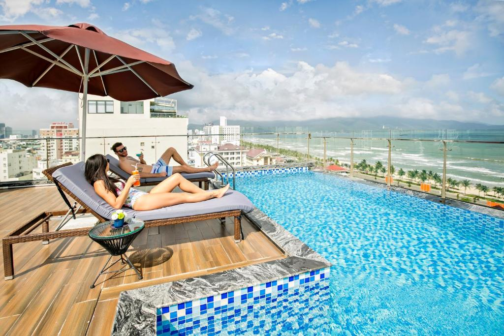 The swimming pool at or close to Halina Hotel and Apartment