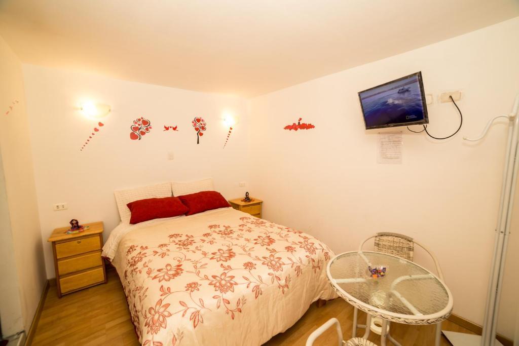 Cama o camas de una habitación en Hospedate