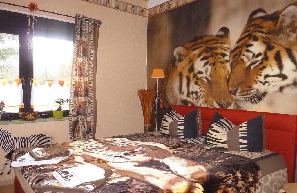 Ein Bett oder Betten in einem Zimmer der Unterkunft 1 Ferienwohnung & 6 Gästezimmer