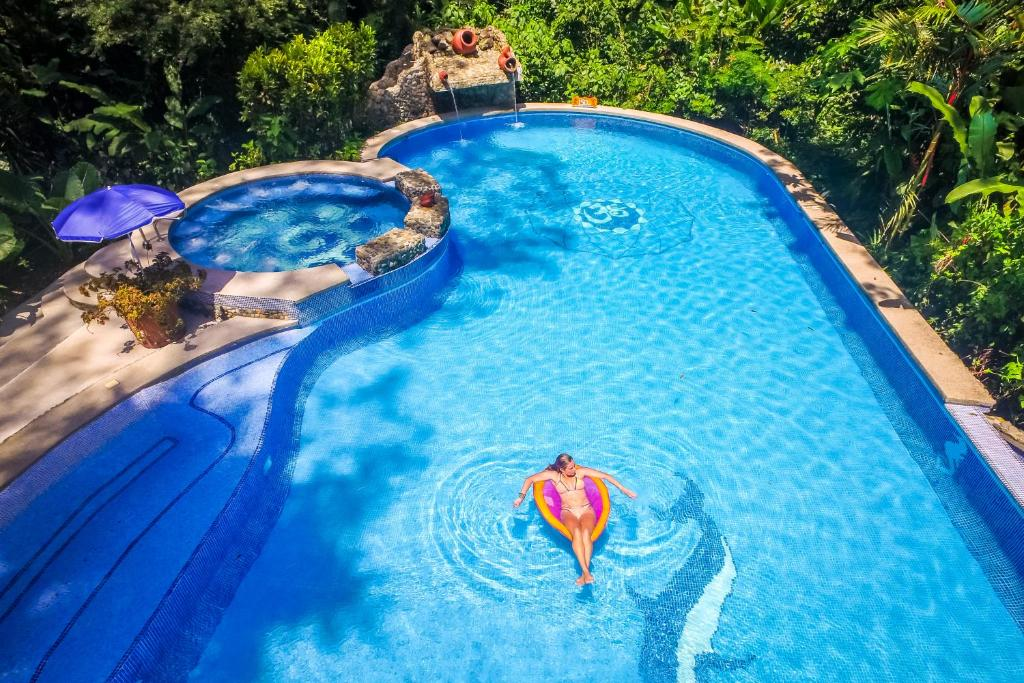 The swimming pool at or close to The Goddess Garden Eco-Resort