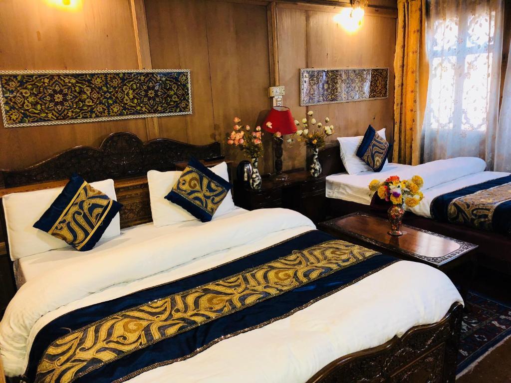 Cama o camas de una habitación en Lake Victoria Group of House Boat