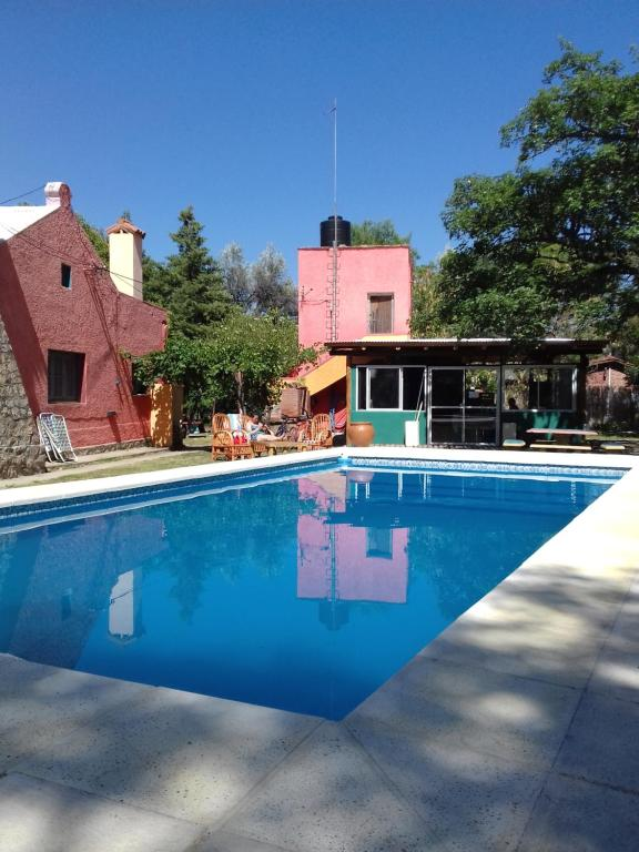 The swimming pool at or near Hostel El Altillo