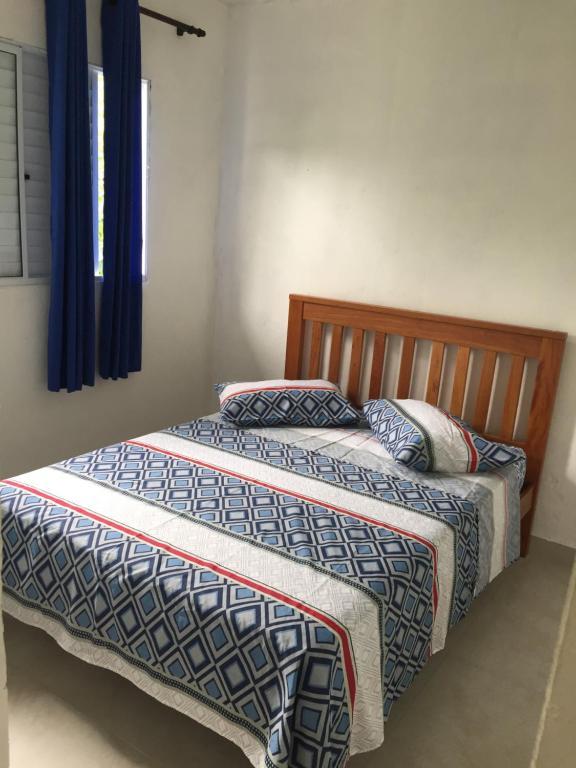 Cama ou camas em um quarto em Residencial Villa Nova