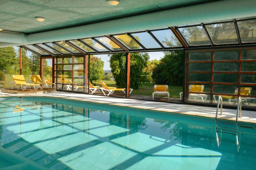 The swimming pool at or near Logis Luccotel Cosy