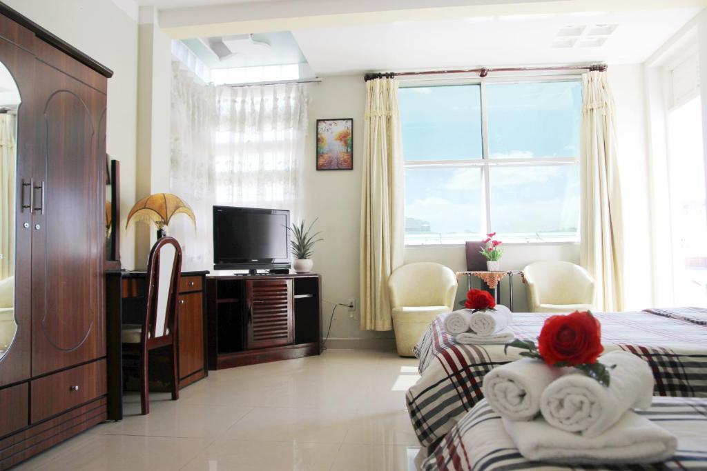 Een TV en/of entertainmentcenter bij Villathol Hotel