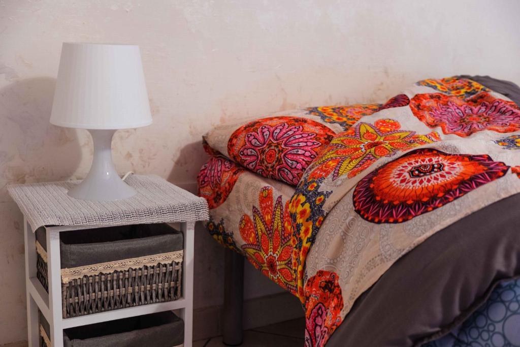 Un pat sau paturi într-o cameră la You are Welcome