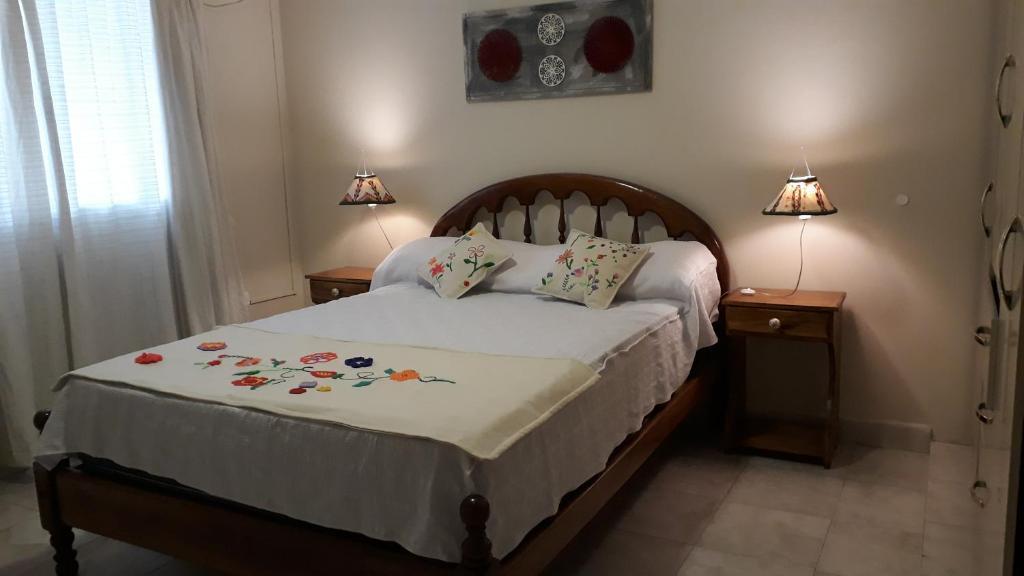 Una cama o camas en una habitación de Apart Polonia