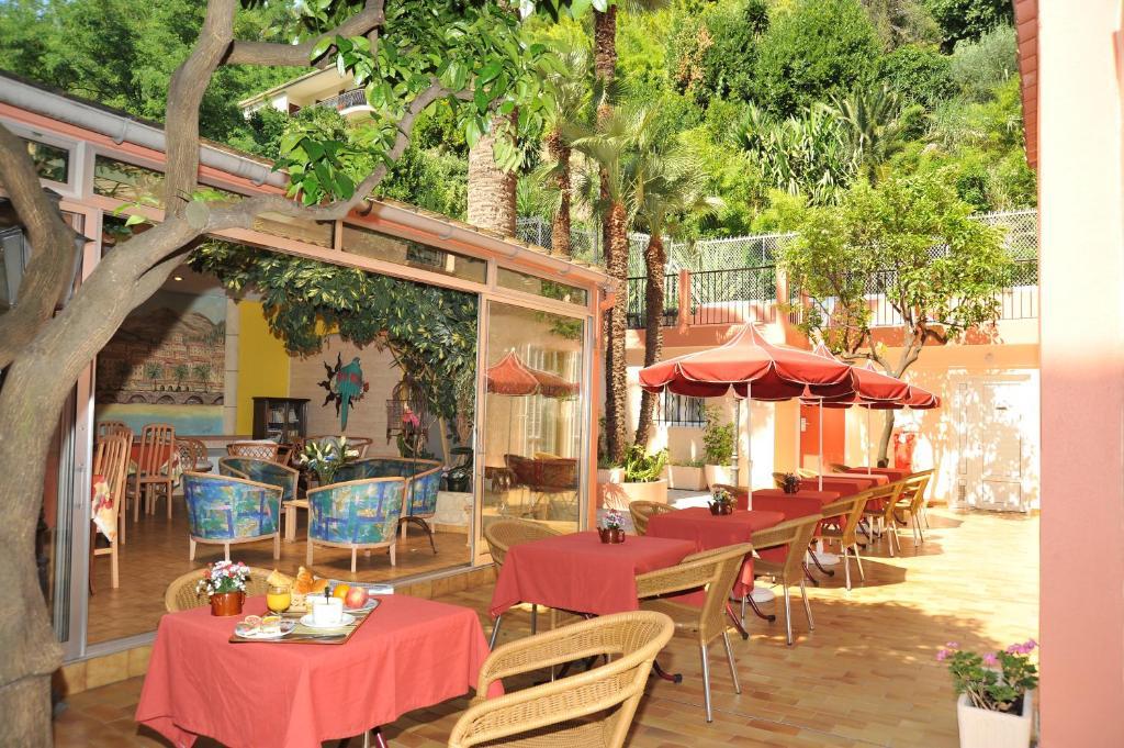 Restaurant ou autre lieu de restauration dans l'établissement Hotel Menton Riviera
