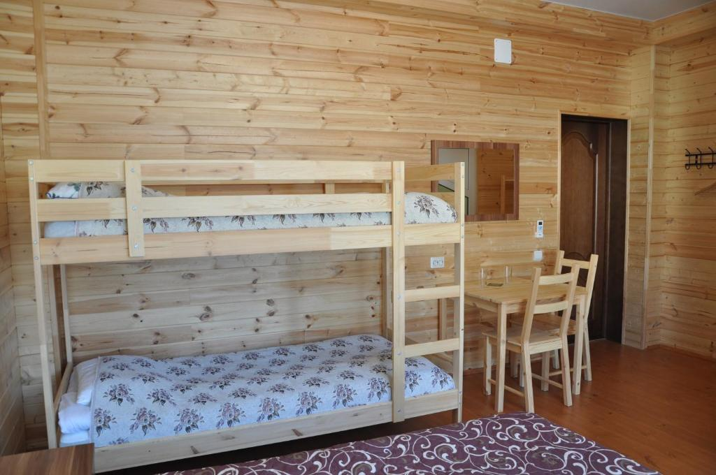 A bunk bed or bunk beds in a room at Lesnoy Guest House
