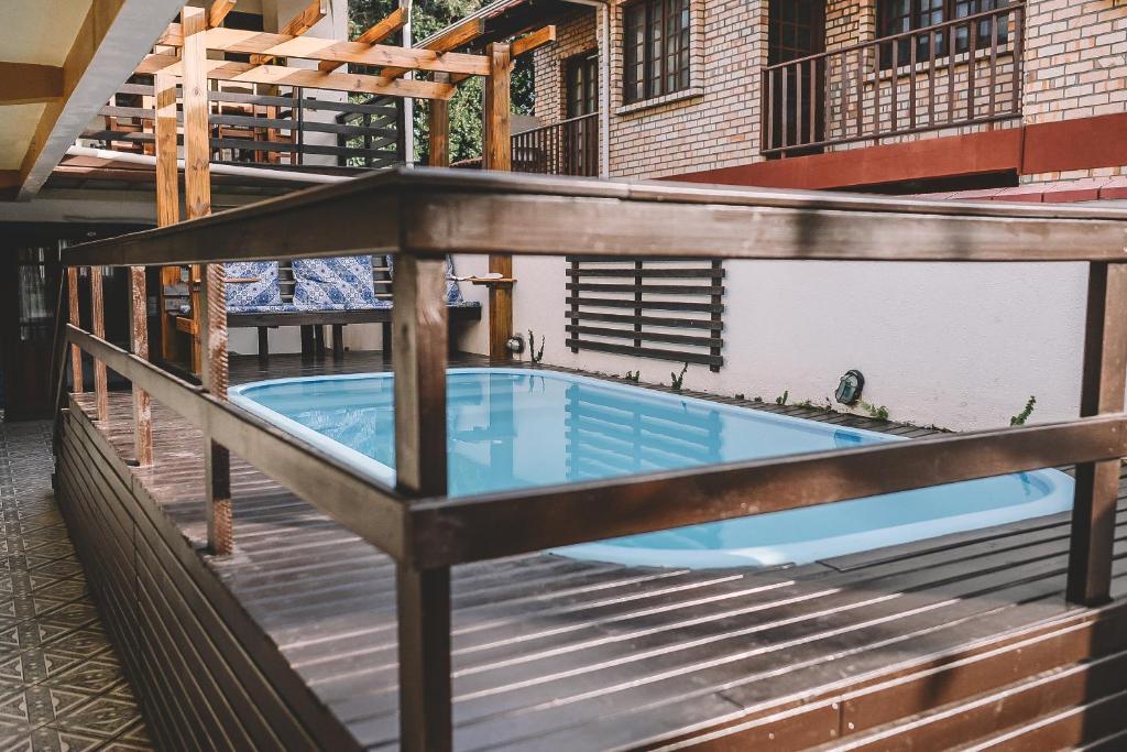 The swimming pool at or near Pousada Gruta do Monge