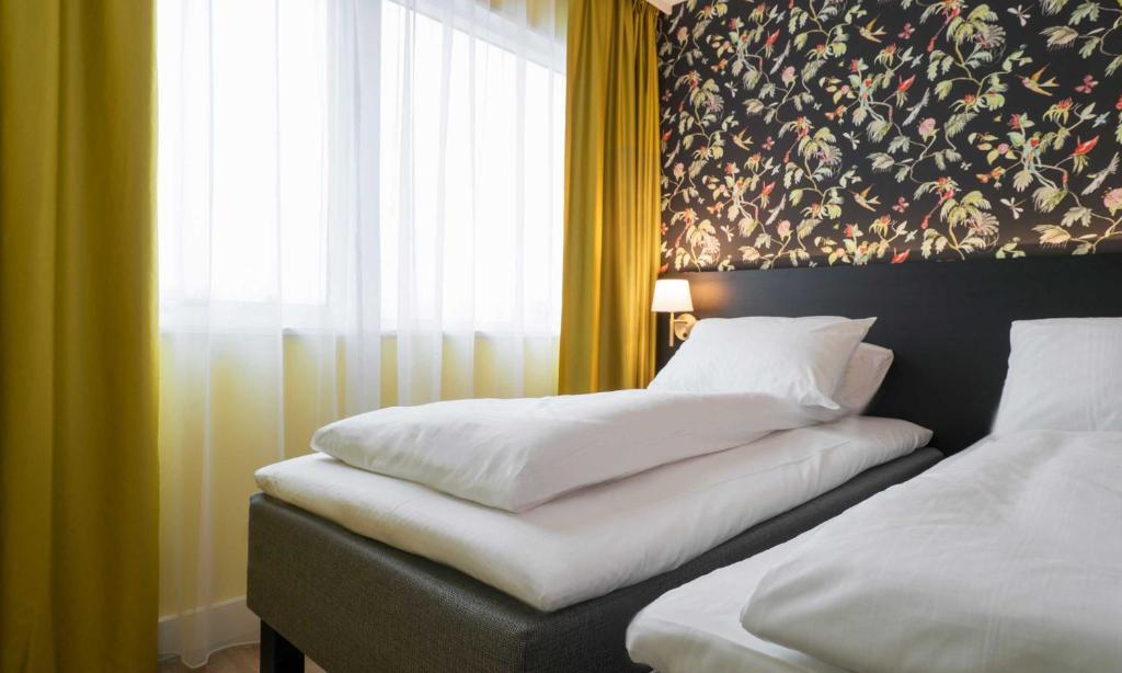 Lova arba lovos apgyvendinimo įstaigoje Thon Hotel Triaden