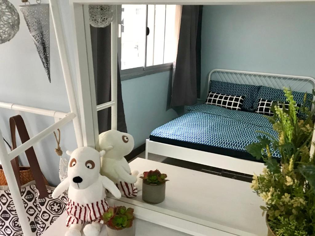 A bed or beds in a room at Nesto Condo at Muangthong