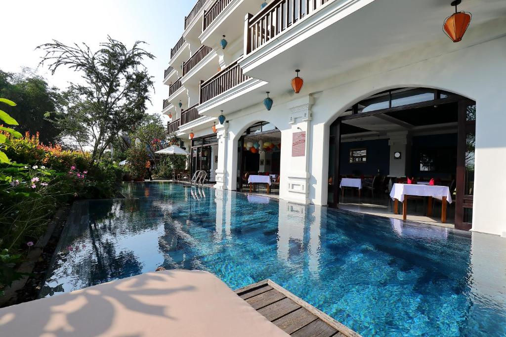 The swimming pool at or near Hoi An Odyssey Hotel